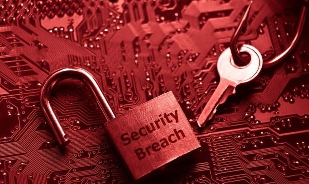 unlock security lock on computer circuit board - computer security breach concept